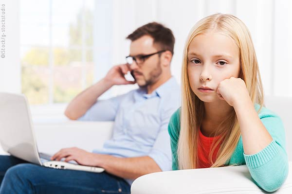 Father on cell phone ignoring daughter
