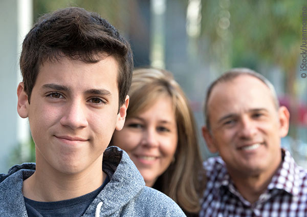 teen boy with parents