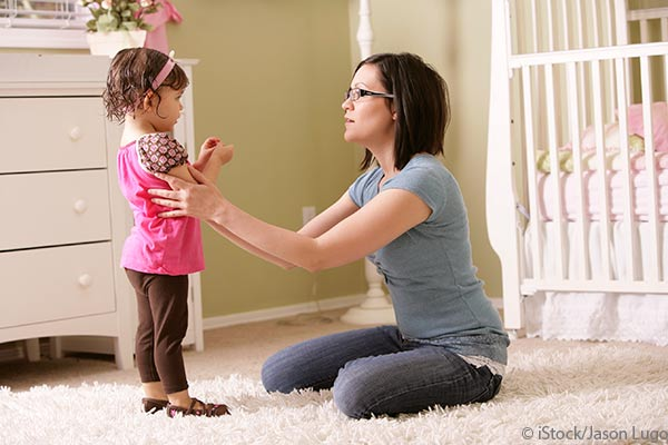mom holding and talking to daughter