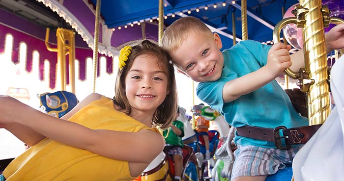 boy and girl on carousel