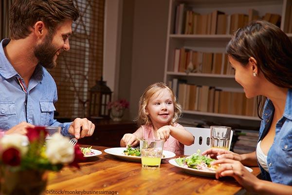 family talking at dinner