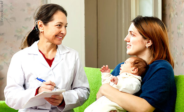 mother with newborn talking to therapist