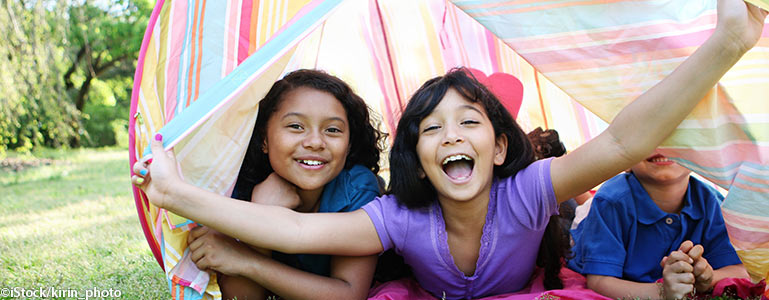 Kids playing in tent