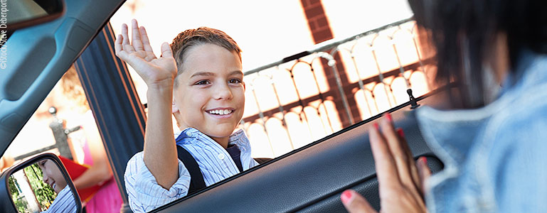 boy being dropped off at school