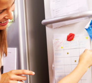 mother and child looking at behavior chart