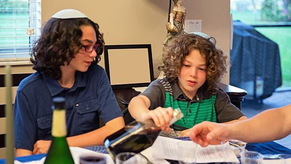 Teen and tween at Seder