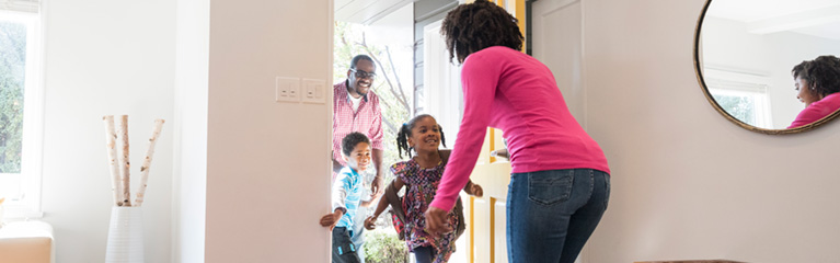 children coming home from school with dad, greeting mom