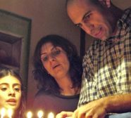 family lighting menorah