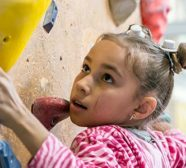 young girl climbing wall