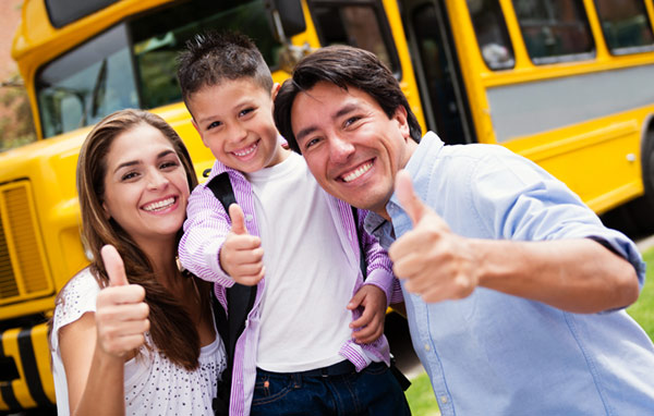 family in front of school bus
