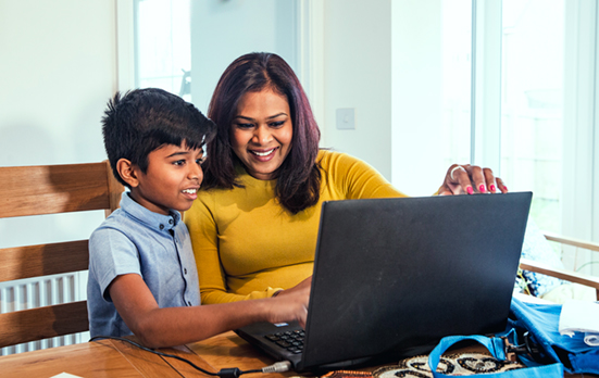 Mother and son looking at computer