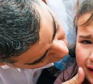 Dad comforting daughter