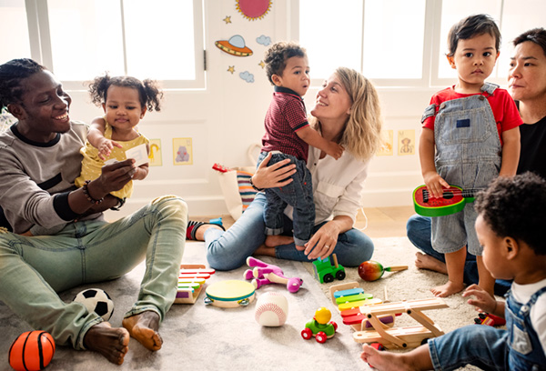 Parents and kids in playroom