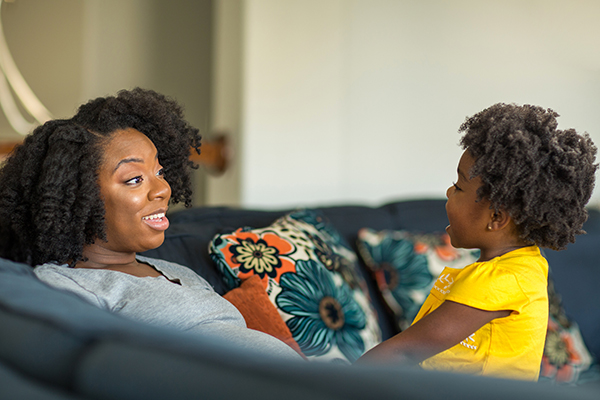 African American mother talking with her daughter.