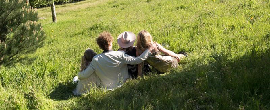 Family sitting in field