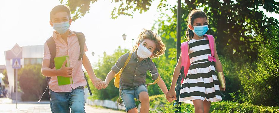 Kids in COVID masks walking to school